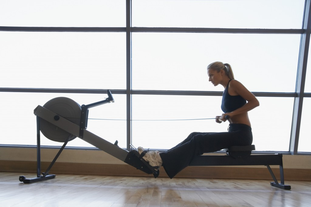 Women Using Rowing Machine